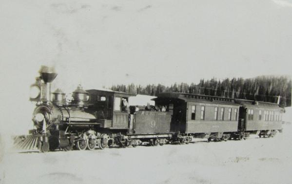Rio Grande Southern Railway Company Locomotive No. 9 in regular passenger service with 2 car passenger train somewhere in the Colorado Rockies circa 1870's.