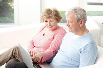 Older couple using a computer