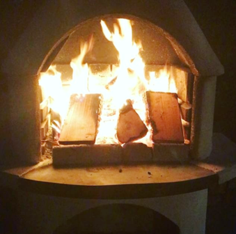 roaring outdoor pizza oven - chef tiffany friedman of butterroot