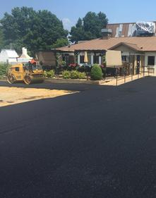 Beltway crew installing final surface paving