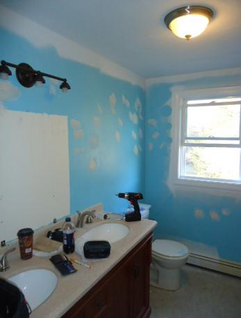 Prepping hall bathroom in Taunton, MA.