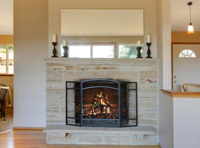 Photo of fireplace with custom frameless mirror