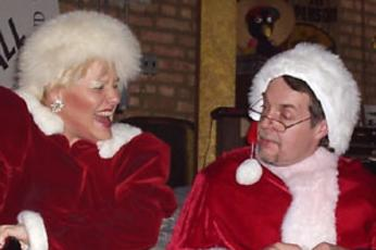 Mrs Santa laughs with Santa Claus