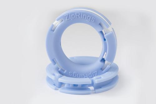 Closeup of Zip Rings, patented design As shown, comes preloaded with dental floss