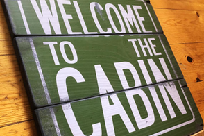 rustic wood sign - welcome to the cabin