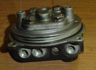 Used valve body for Chrysler and Force outboard motors.