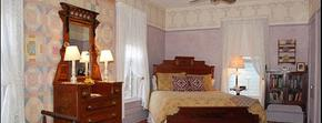 Wedgwood Inn of New Hope, PA Accommodations - Special Amenity Rooms & Suites, Carriage House & Whirlpool Tub Suites, Special Packages Image of Room with antique bed, dresser, lamps