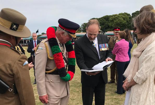 Craig Lawrence and Laura Lawrence discussing the new Gurkha book with Prince Charles