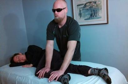 man receiving bodywork from a Certified Instructor