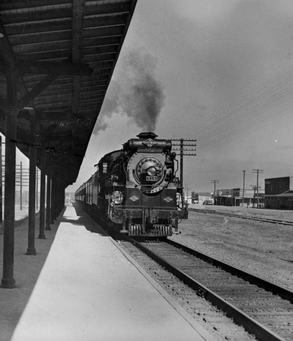 A steam locomotive pulls the Texas and Pacific passenger train, The Sunshine Special.