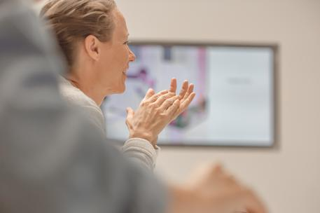 woman clapping after presentation screen background