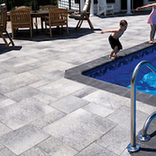 Pool Decking Patio Flat Smooth Paver Umbriano® with boy jumping in pool