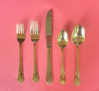 Vintage gold flatware place settings for wedding rentals at Rent Your Event, LLC in Charlotte, NC.