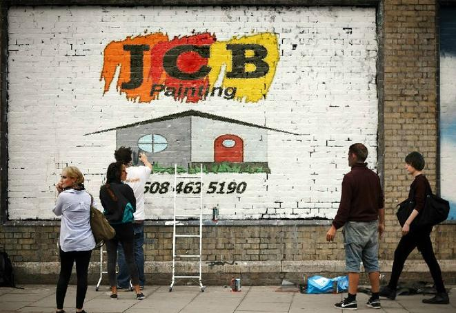 Jcb Painting logo painted on a wall