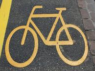 Bicycle safety sign on roadway