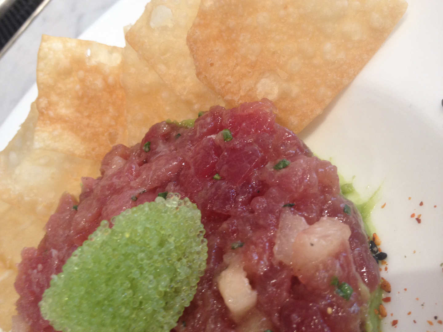 Tuna Poke Salad Topped with Tobiko Served with a Side of Tortilla Chips