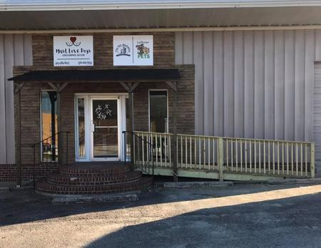 116 W. Athens Street, Winder GA Facility. Small yellow house with nice yard and balloons.