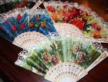 Hand fans that are perfect purse size for hot summer outings.