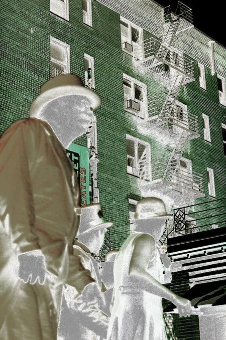 photo with inverted color, ghostly looking middle-aged fellow facing fight, with walrus moustache, suit and bowler hat, and two young people behind him festively dressed with hats, also ghostly, looking back at green brick building, urban scene, black sky