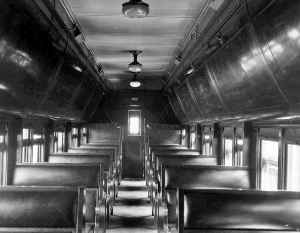 Interior view of a Canadian National Railways colonist car. Note the two open berths at far end of the car, circa 1926.