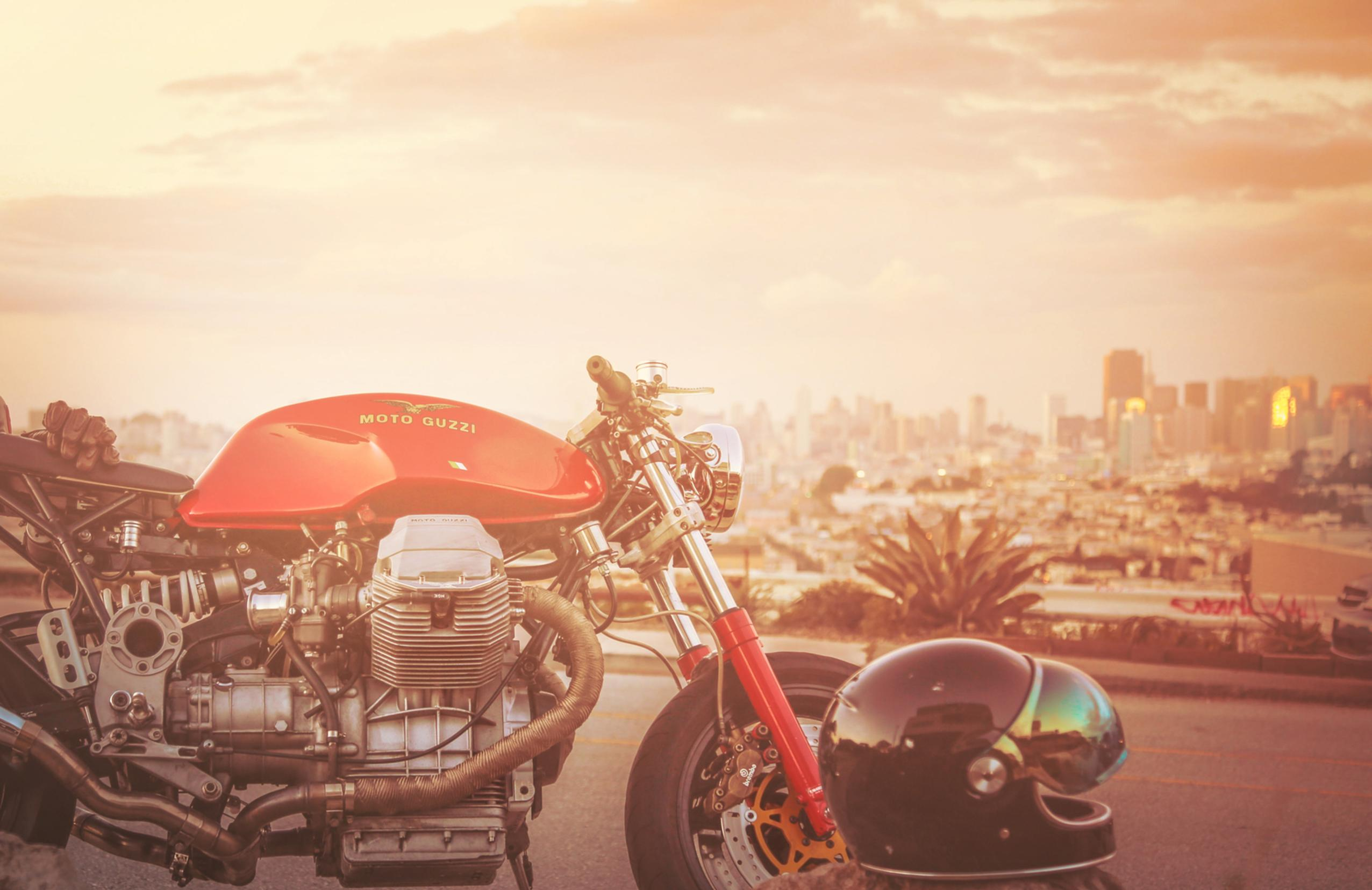 san francisco overview with cafe racer motorcycle and sunset