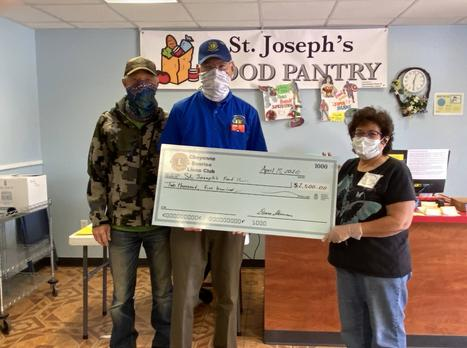 Sunrise Lions Jerry Egge and Deane Skinner present $2,500 check to St. Joseph's Food Bank