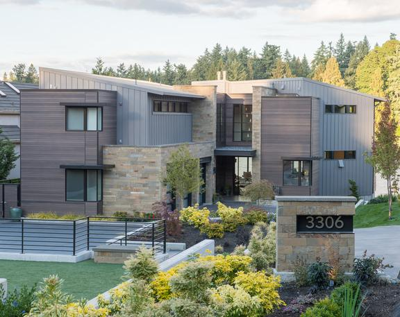 Custom stained, clear vertical grain Western Red Cedar clads this modern home in Medina WA