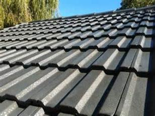 dark concrete tile roof in Houston; Houston roof contractor