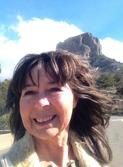 Big Bend Artist Lindy Cook Severns in front of Casa Grande in the Chisos Basin of Big Bend National Park