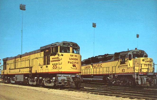 A pair of 5,000 hp brutes pose for the camera at the Union Pacific facilities in North Platte, Nebraska. On the left, No. 53, a GE U50D, and on the right, No. 82, a General Motors EMD DD35A.