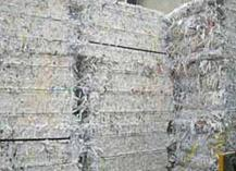 Bales of shredded paper to be collected for recycling