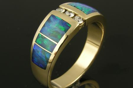 Diamond and opal ring expertly repaired by Hileman.