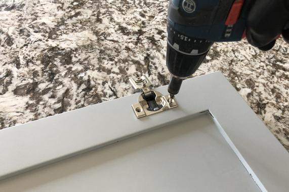 Installing hardware on kitchen cabinets