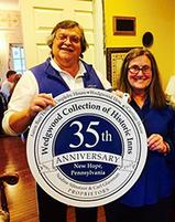Nadine and Carl Glassman, Innkeeper Owners of the 1870 Wedgwood Inn Bed and Breakfast, New Hope, PA holding 35th Anniversary Plaque