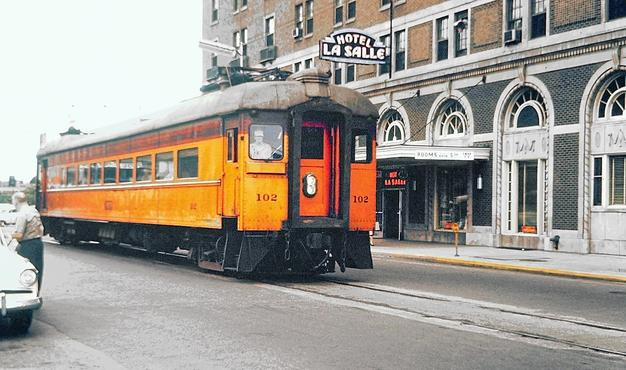 Chicago, South Shore and South Bend No. 102, built by Pullman-Standard in 1926, street-running in South Bend, Indiana in 1962.