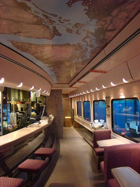 Inside the bistro car with the route on the ceiling.
