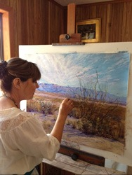 Big Bend Artist Lindy Cook Severns at her easel at Old Spanish Trail Studio outside Fort Davis, Texas