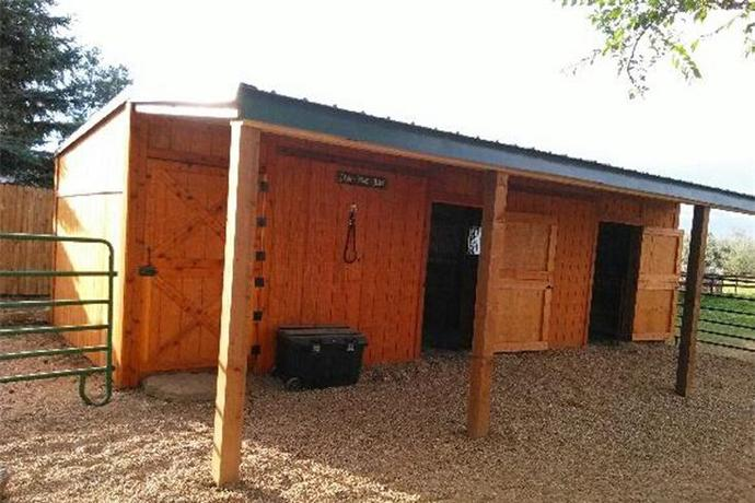 Horse barn, row barn, tack room, loafing shed with Dutch doors, horse barn, run-in sheds, hay storage