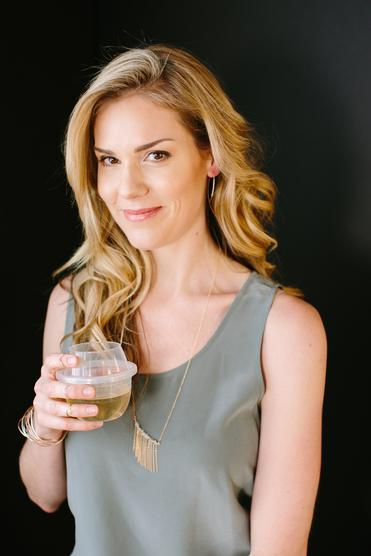 Jessica Bell, inventor and owner of HaloVino, holding a HaloVino wine tumbler.