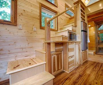 Walls are lined with knotty cedar in this tiny home