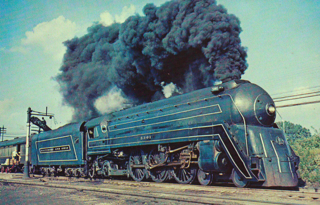 Postcard photo of the Baltimore and Ohio train The Cincinnatian when it was a streamlined steam locomotive. The locomotive shown is No. 5301, The President Adams, a 4-6-2 Pacific style locomotive. The photo was taken in July 1956; a few months later, the train was powered by a diesel locomotive.