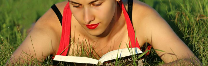 Young woman relaxing in the sun reading a book - Philip Oldfield - Author