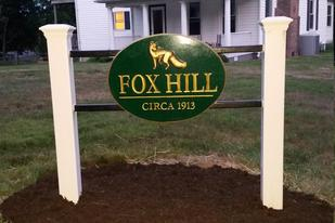 Oval plaque house sign