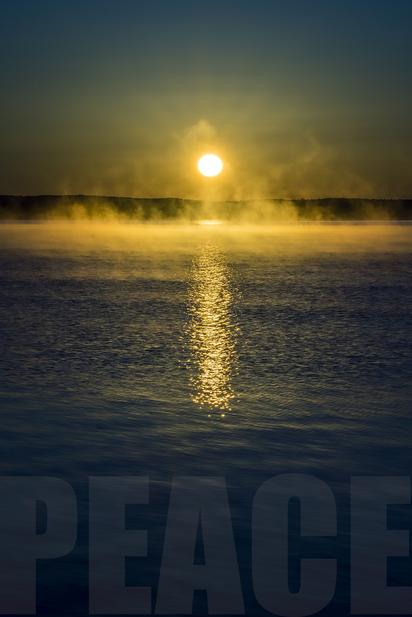 "A picture of a sunrise with the word ""PEACE"""