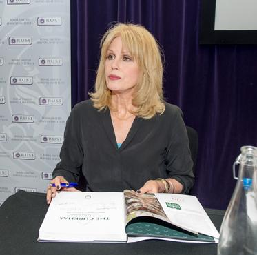 Joanna Lumley signing a copy of the Gurkha history