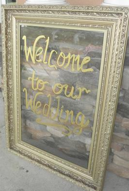Vintage gold frame holding acrylic signage for wedding rentals at Rent Your Event, LLC.