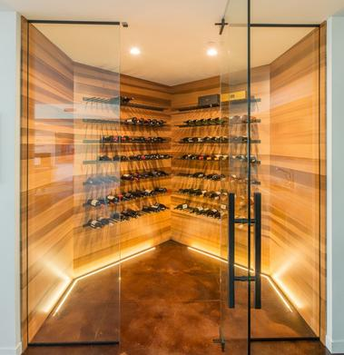 High quality clear, vertical grain Western Red Cedar lines this wine room in a high end custom home in Medina, WA