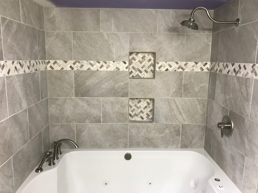 We Installed Relaxing This 2 Person Whirlpool Tub Surrounded With Porcelain Tiles The Accent Strip And Niches Are Created Mosaic Marble