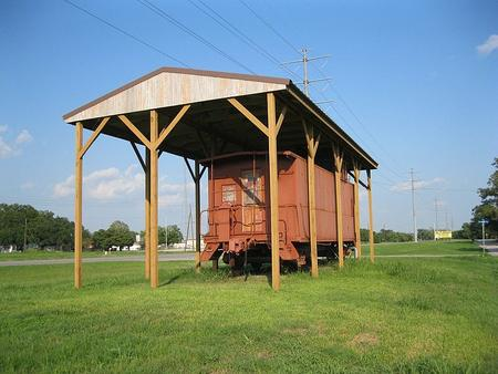 A caboose sits on the old Cane Belt right-of-way at FM 102 and Branch St in Wharton.