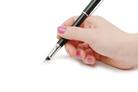 a still image of a hand holding a black pen, giving the impression that they are about to write a travel blog